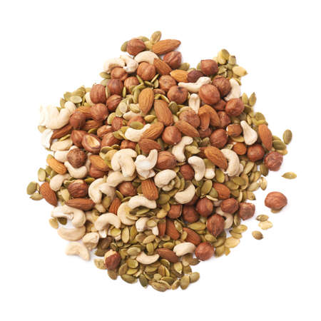 Pile of multiple nuts and seeds isolated over the white background Standard-Bild