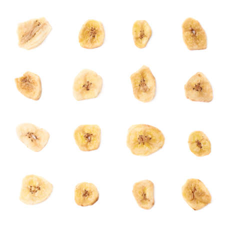 Set of multiple dried banana slices snacks isolated over the white background photo