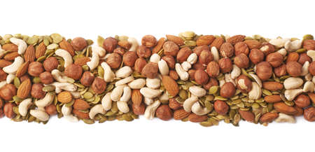 mixed nuts: Line border made of multiple different nuts and seed mix, composition isolated over the white background Stock Photo