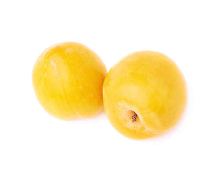 Multiple yellow mirabelle plum fruits composition isolated over the white background photo