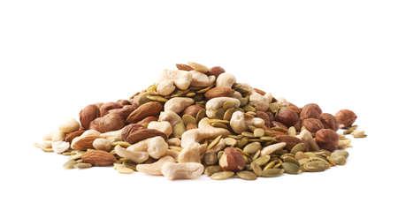 semilla: Pila de varias nueces y semillas aisladas sobre el fondo blanco Foto de archivo