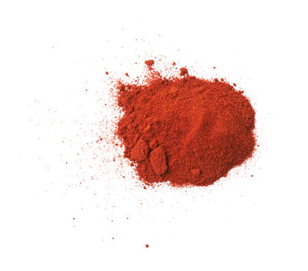 Pile of red chili paprika powder isolated over the white background Banco de Imagens