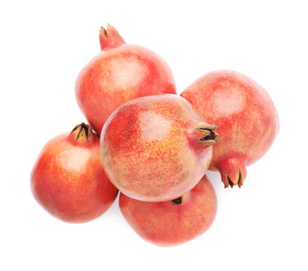 granatum: Pile of multiple pomegranate Punica granatum fruits isolated over the white background