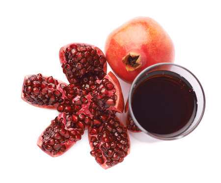 granatum: Pomegranate Punica granatum fruit next to the tall glass full of red juice, composition isolated over the white background Stock Photo