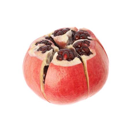 granatum: Cut in segments pomegranate Punica granatum fruit isolated over the white background
