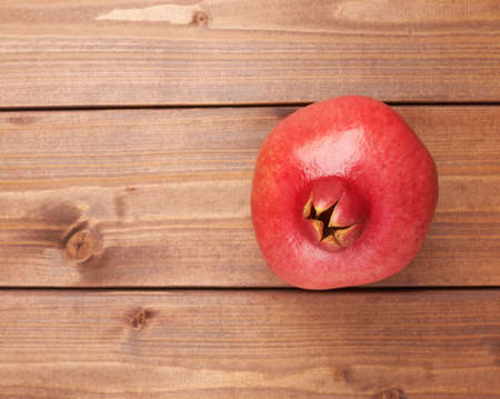 punica granatum: Pomegranate Punica granatum fruit composition placed over the wooden boards surface