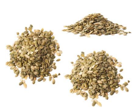 semilla: Pila de semillas de calabaza aisladas sobre el fondo blanco, conjunto de tres escorzos diferentes Foto de archivo