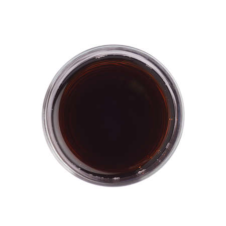 foreshortening: Tall glass filled with the red juice isolated over the white background, top view above foreshortening Stock Photo