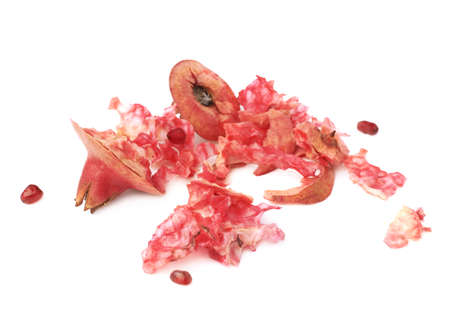 remains: Eaten pomegranate remains and lumps isolated over the white background