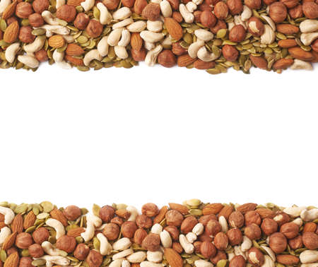 Copyspace background composition with the borders made of multiple different nuts and seeds isolated over the white background