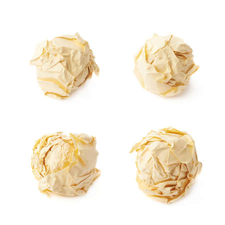 crumple: Crumple yellow paper ball isolated over the white background, set of four foreshortenings Stock Photo
