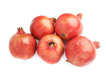 punica granatum: Pile of multiple pomegranate Punica granatum fruits isolated over the white background