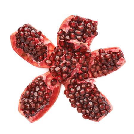 punica granatum: Split open flower served pomegranate Punica granatum fruit isolated over the white background Stock Photo
