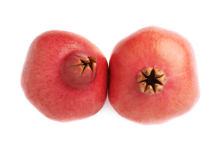 granatum: Two pomegranate punica granatum fruits composition isolated over the white background