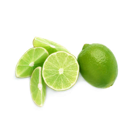limes: Served lime fruit composition isolated over the white background, top view Stock Photo