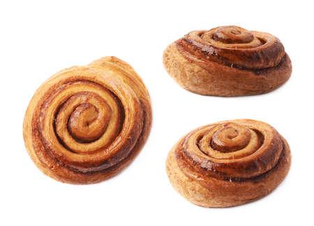 cinnamon swirl: Sweet cinnamon bun roll swirl isolated over the white background, set of three different foreshortenings