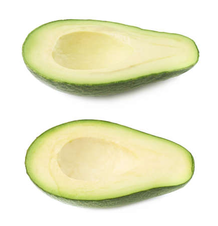 avacado: Half of ripe avacado fruit without the pit, composition isolated over the white background, set of two different foreshortenings Stock Photo