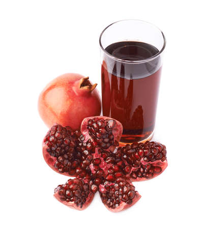 punica granatum: Pomegranate Punica granatum fruit next to the tall glass full of red juice, composition isolated over the white background Stock Photo