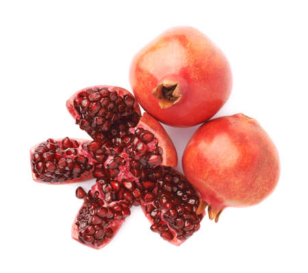 punica granatum: Split open flower served pomegranate Punica granatum fruit composition isolated over the white background Stock Photo