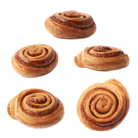 sweet foods: Sweet cinnamon bun roll swirl isolated over the white background, set of five different foreshortenings Stock Photo