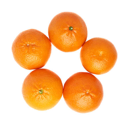 Multiple ripe juicy tangerines aligned in a circle round frame, composition isolated over the white background, top view Stock Photo