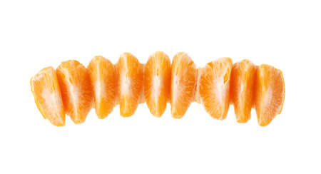 cleaned: Line of fresh juicy peeled cleaned tangerine fruit isolated over the white background, top view