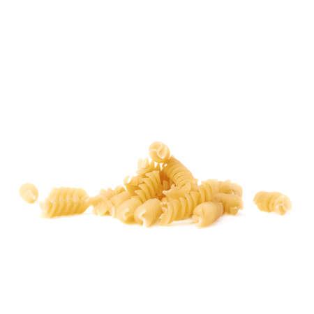 rotini: Pile of dry rotini yellow pasta over isolated white background Stock Photo