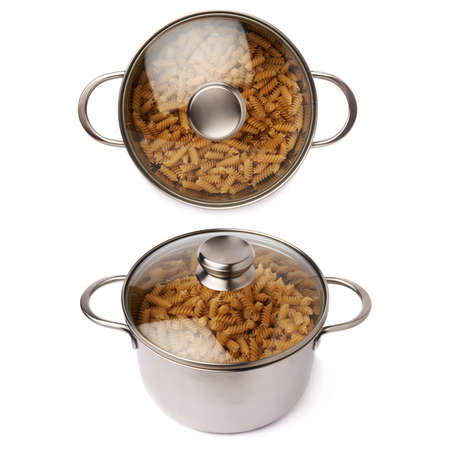 rotini: Metal pan with glass lid filled with dry rotini yellow pasta over isolated white background