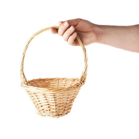 basket: Caucasian male hand holding a wicker basket, composition isolated over the white background