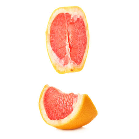 sweet segments: Slice section of ripe grapefruit isolated over the white background