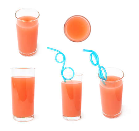flesh colour: Tall glass filled with the fresh grapefruit juice isolated over the white background