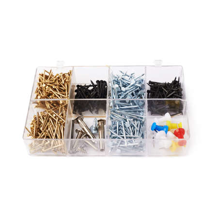 inflexible: Collection of nails in plastic box isolated over white background