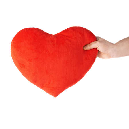 gently: Gently holding plush red plush toy heart with one hand, composition isolated over the white background