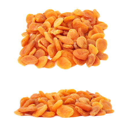 dried orange: Pile of dried orange apricots over isolated white background Stock Photo