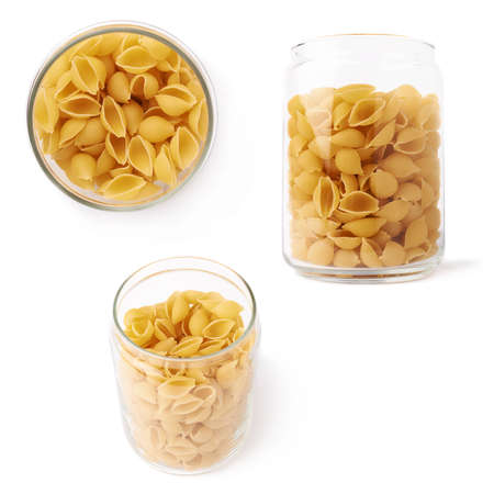 a jar stand: Set of glass jar filled with dry conchiglie yellow pasta over isolated white background, different foreshortenings