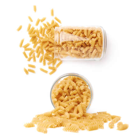 rotini: Set of glass jar filled with dry rotini yellow pasta over isolated white background, different foreshortenings Stock Photo