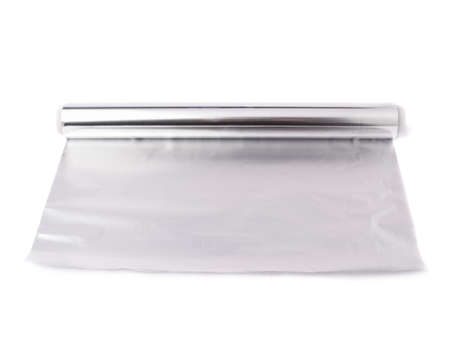 foil roll: Roll of aluminium gray foil paper over isolated white background Stock Photo