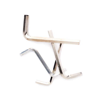 furniture hardware: Pile of hex metal allen S and L keys over white isolated background