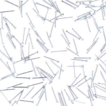 inflexible: Scattered metal nails over surface isolated over white background
