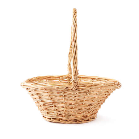 hand basket: Brown small wicker basket isolated over the white background