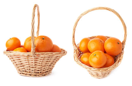 Wicker basket full of multiple ripe orange fresh juicy tangerines, composition isolated over the white background,  set Stock Photo