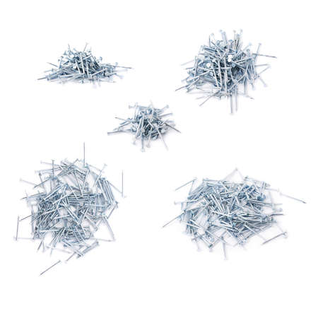 inflexible: Set of pile of metal nails isolated over white background, different foreshortenings