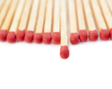 unlit: Pile of Wooden unused matches isolated over the white background, as chosen one concept