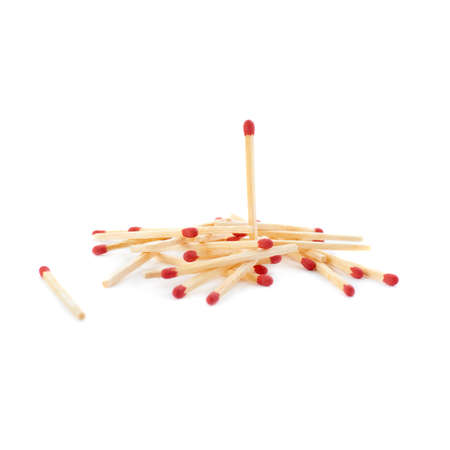 chosen: Pile of Wooden unused matches isolated over the white background, as chosen one concept
