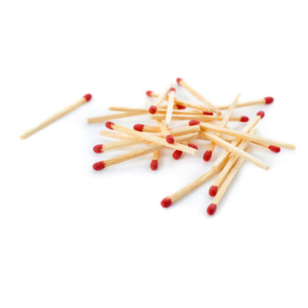 chosen one: Pile of Wooden unused matches isolated over the white background, as chosen one concept