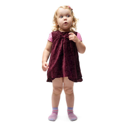 questioned: Young little girl with curly hair in purple dress standing over isolated white background