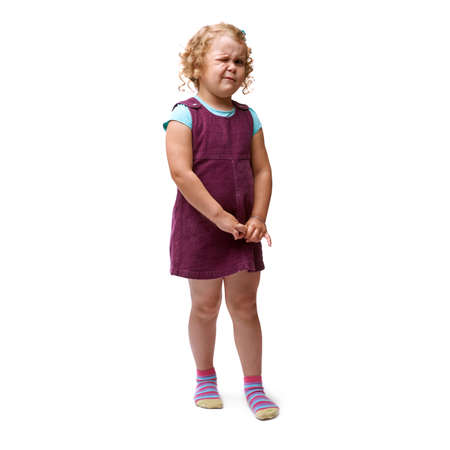 eye closed: Young little girl with curly hair and one eye closed in purple dress standing over isolated white background