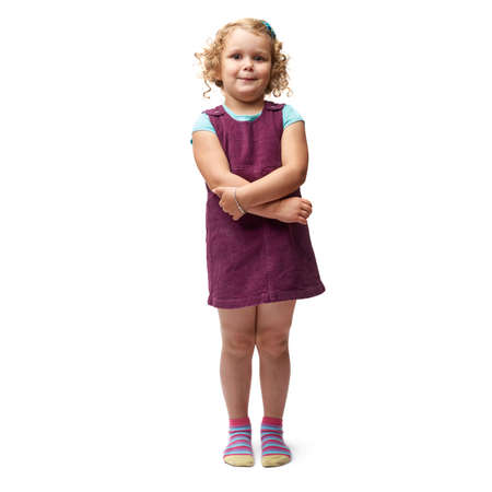 HESITATE: Young little girl with curly hair in purple dress standing over isolated white background