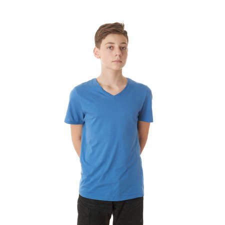 blonde boy: Cute teenager boy in blue T-shirt over white isolated background, half body Stock Photo