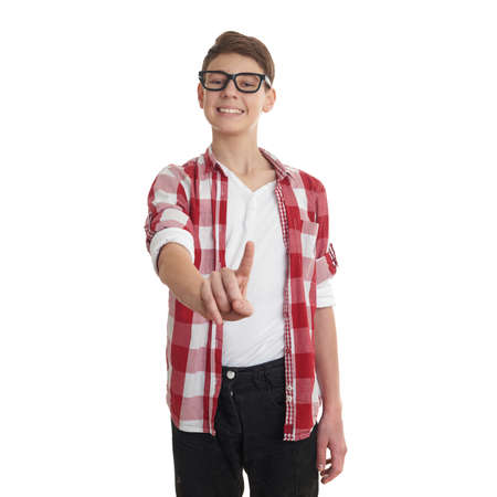 poor eyesight: Cute teenager boy in red checkered shirt and glasses pushing something in front of himself over white isolated background, half body